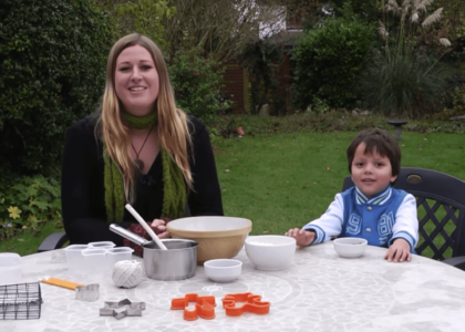 A woman and boy making bird seed cake
