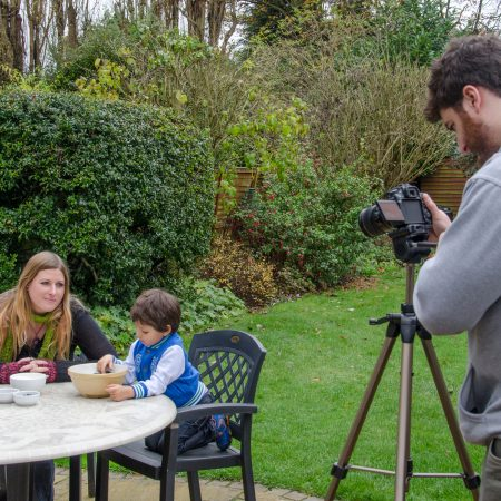 Michael filming Laura and Tiago making bird seed cake in the wildlife garden