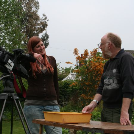 Laura and David with camera in a wildlife garden
