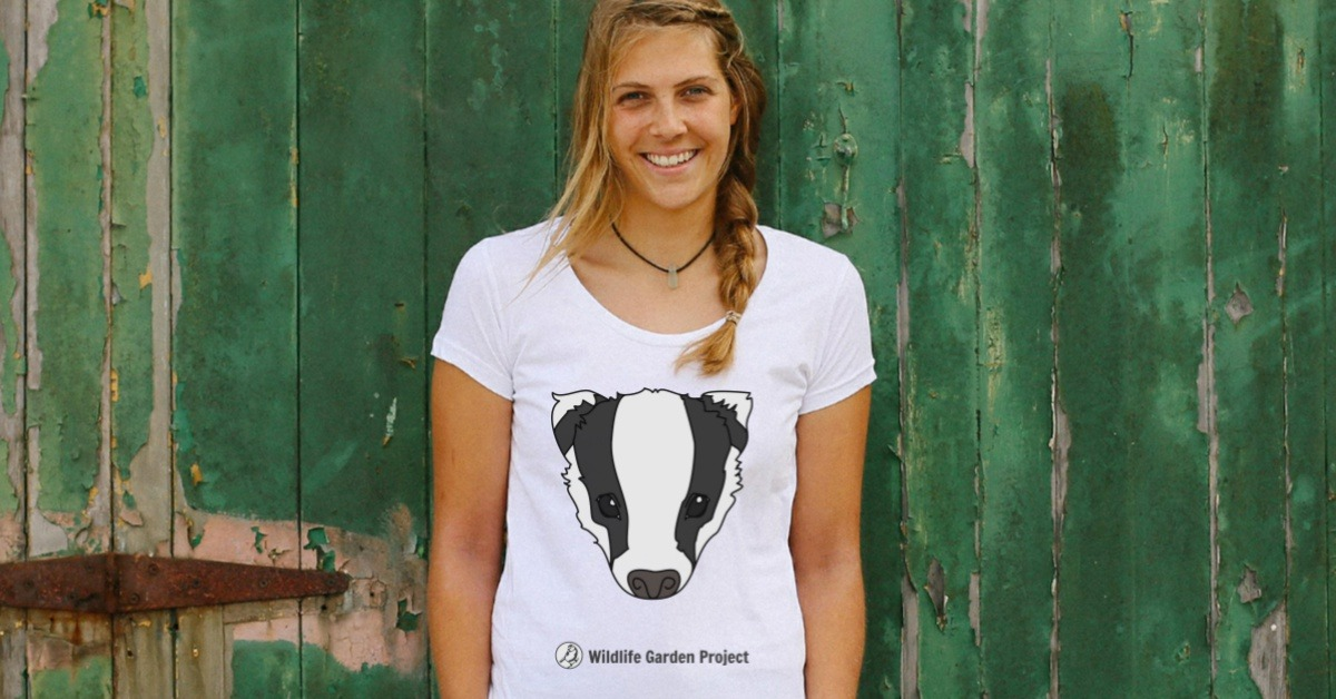 Woman wearing wildlife garden project t-shirt with badger