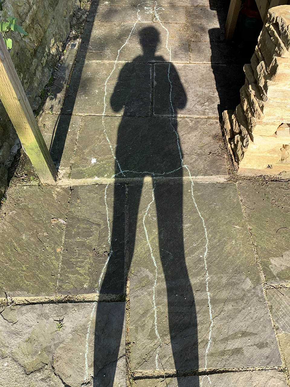 A shadow on the ground with an outline around it