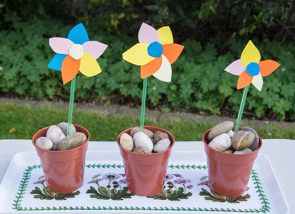 3 colourful paper flowers in pots
